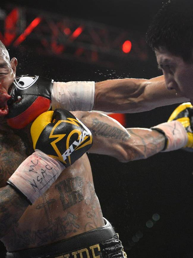 In this Sept. 14, 2013 file photo, Pablo Cesar Cano, right, lands a punch against Ashley Theophane in the eighth round during a welterweight fight in Las Vegas. The photo was part of a series of images by photographer Mark J. Terrill which won the Thomas V. diLustro best portfolio award for 2013 given out by the Associated Press Sports Editors during their annual winter meeting in Indianapolis