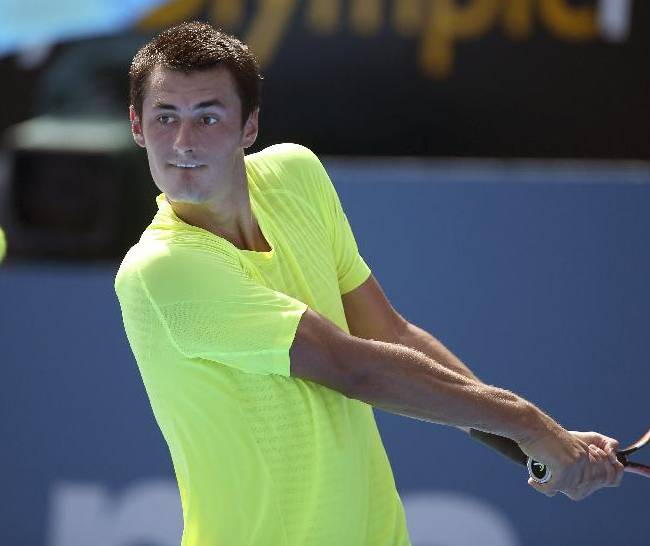 Bernard Tomic of Australia plays a shot to Igor Sijsling of the Netherlands during their match at the Sydney International tennis tournament in Sydney, Tuesday, Jan. 13, 2015