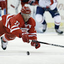 Carolina Hurricanes' Manny Malhotra (22) dives while chasing the puck against the Washington Capitals during the second period of an NHL hockey game in Raleigh, N.C., Thursday, April 10, 2014 The Associated Press