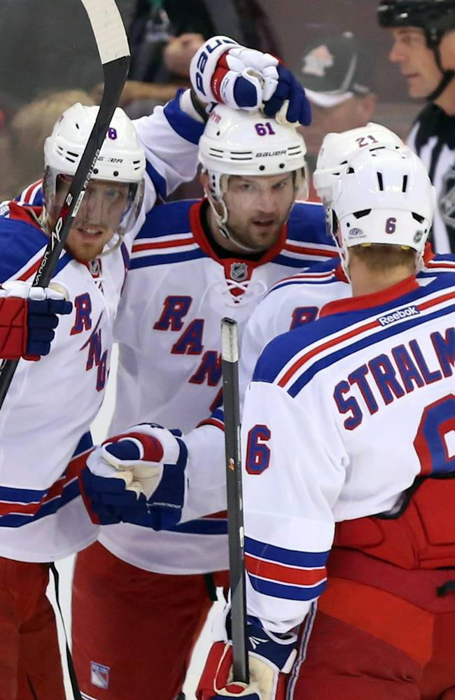 New York Rangers' Rick Nash (61) celebrates his goal against the Ottawa Senators with teammates Anton Stralman (6) and Marc Staal (18) during first period NHL action in Ottawa,  Ontario, Tuesday March 18, 2014