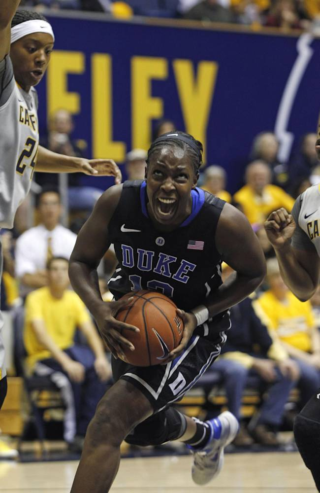 Duke's Chelsea Gray, center, drives for the basket through California's Courtney Range, left, and Mercedes Jefflo during the first half of an NCAA college basketball game, Sunday, Nov. 10, 2013 in Berkeley, Calif