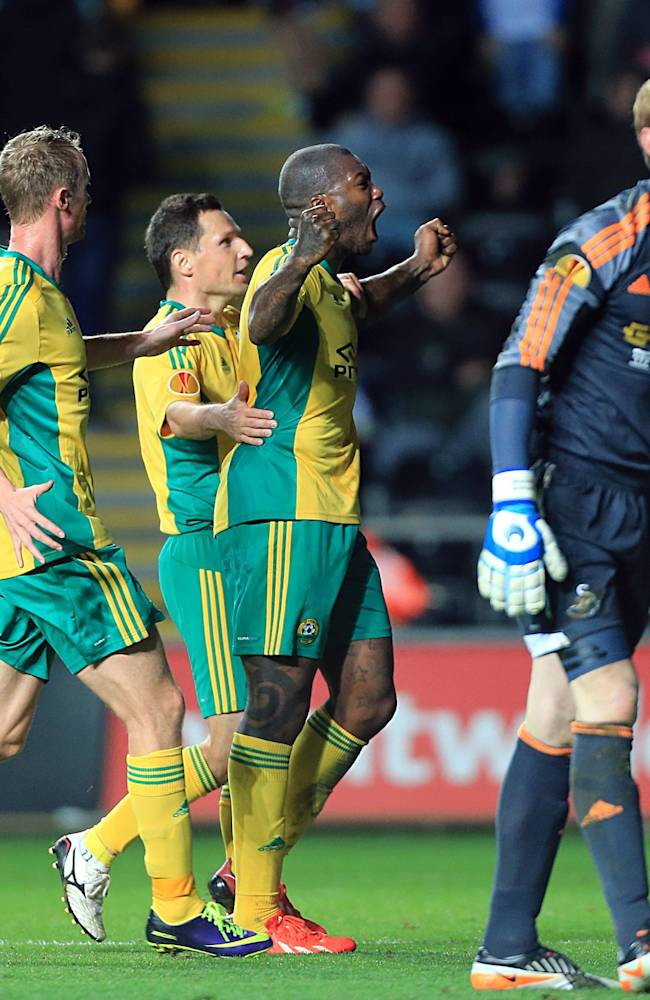 Kuban Krasnodar's Djibril Cisse, second right, celebrates scoring an equalising goal from the penalty spot during their Europa League group A soccer match against Swansea City at the Liberty Stadium, Swansea, Wales, Thursday Oct. 24, 2013