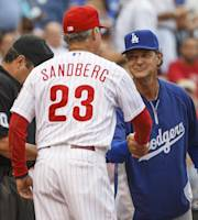 Los Angeles Dodgers manager Don Mattingly, right, shakes hands with Philadelphia Phillies interim manager Ryne Sandberg as they hand in their line-up cards before a baseball game on Friday, Aug. 16, 2013, in Philadelphia. (AP Photo/Christopher Szagola)