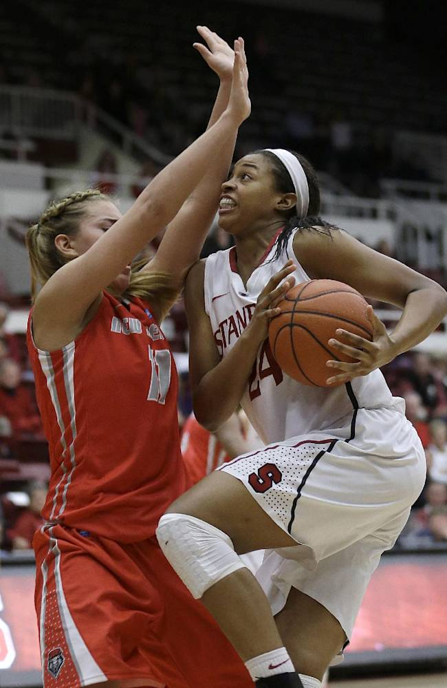 Stanford forward Erica McCall, right, shoots against New Mexico forward Alexa Chavez (11) during the second half of an NCAA college basketball game in Stanford, Calif., Monday, Dec. 16, 2013. Stanford won 75-41
