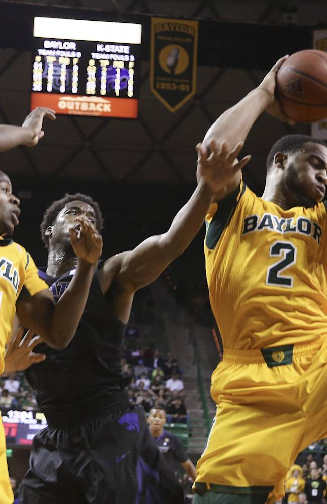 Baylor forward Rico Gathers (2), right, pulls down a rebound over Kansas State forward Nino Williams (11), center, and Baylor guard Kenny Chery, left, during the first half of an NCAA college basketball game, Saturday, Feb. 15, 2014, in Waco, Texas