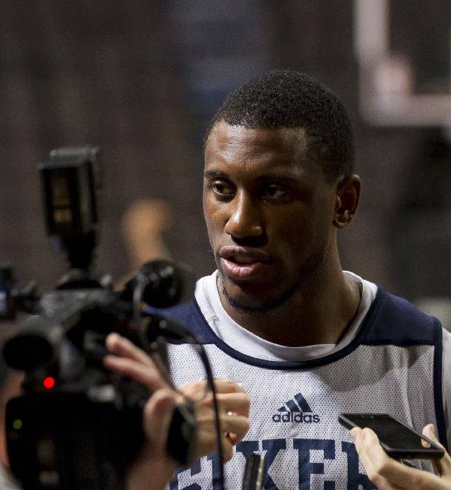 Thaddeus Young speaks to the media during a Philadelphia 76ers open practice basketball session in Manchester, England, Monday, Oct. 7, 2013. The Philadelphia 76ers take on the Oklahoma City Thunder in Manchester on Tuesday as part of a series of NBA preseason games