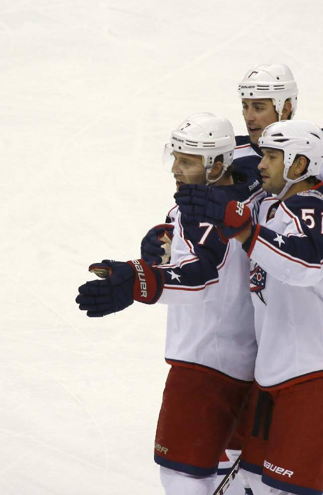 Columbus Blue Jackets' Boone Jenner (38), left, celebrates with teammates after scoring in the first period of the NHL hockey preseason game against the Pittsburgh Penguins on Saturday, Sept. 21, 2013, in Pittsburgh