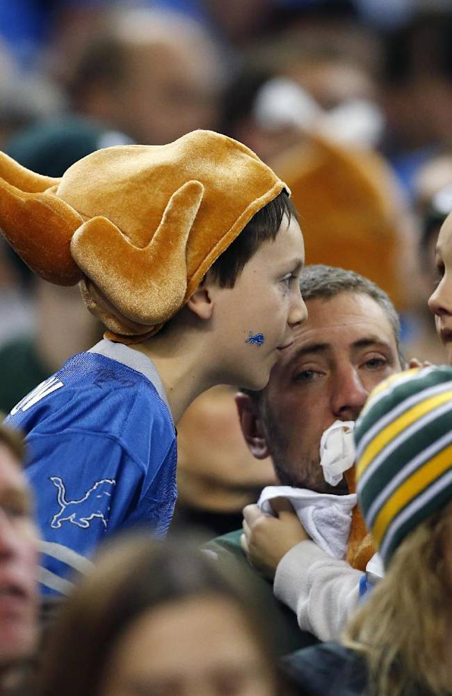 Detroit Lions fans are seen in attendance during the third quarter of an NFL football game between the Lions and the Green Bay Packers at Ford Field in Detroit, Thursday, Nov. 28, 2013