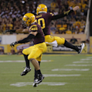 Arizona State running back D.J. Foster, left, celebrates with Taylor Kelly during the second half of an NCAA college football game against Weber State, Thursday, Aug. 28, 2014, in Tempe, Ariz The Associated Press