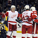 Buffalo Sabres' Tyler Ennis (63) passes a celebration by Detroit Red Wings' Justin Abdelkader (8), Darren Helm (43) and Daniel Alfredsson (11) after Helm scored during the second period of an NHL hockey game in Buffalo, N.Y., Sunday, Nov. 24, 2013 The As