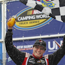Driver Cole Custer celebrates in Victory Lane after winning the Camping World Truck Series at New Hampshire Motor Speedway, Loudon, N.H., Saturday, Sept. 20, 2014. (AP Photo/Cheryl Senter)
