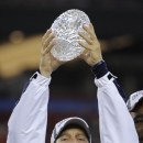 Auburn head coach Gene Chizik holds up the Coaches' Trophy after beating Oregon 22-19 in the BCS National Championship NCAA college football game Monday, Jan. 10, 2011, in Glendale, Ariz. (AP Photo/Mark J. Terrill)