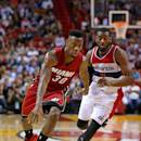 MIAMI, FL - DECEMBER 19: Norris Cole #30 of the Miami Heat drives on John Wall #2 of the Washington Wizards during a game  at American Airlines Arena on December 19, 2014 in Miami, Florida. NOTE TO USER: User expressly acknowledges and agrees that, by downloading and/or using this photograph, user is consenting to the terms and conditions of the Getty Images License Agreement. Mandatory copyright notice:  (Photo by Mike Ehrmann/Getty Images)