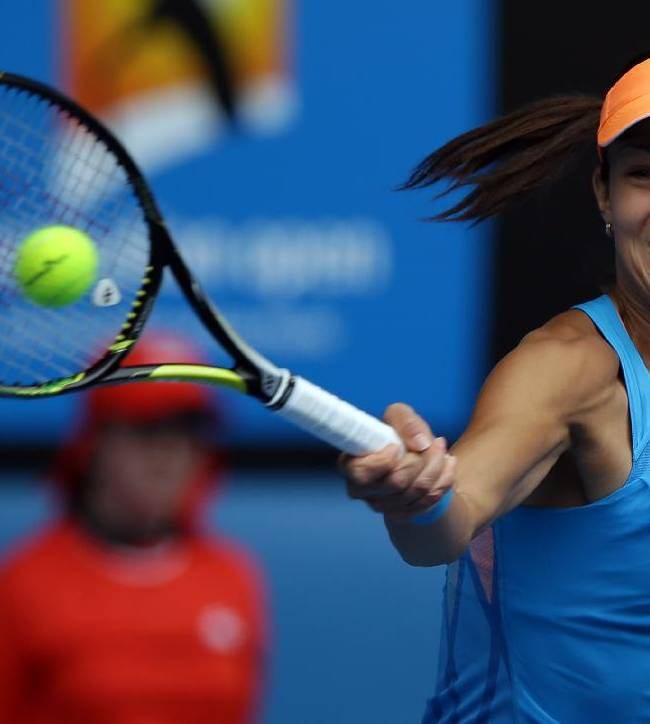 Ana Ivanovic of Serbia makes a forehand return to Serena Williams of the U.S.   during their fourth round match at the Australian Open tennis championship in Melbourne, Australia, Sunday, Jan. 19, 2014
