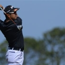 Hideki Matsuyama of Japan watches his tee shot on the sixth hole during the third round of the British Open golf Championship at Muirfield in Scotland July 20, 2013. REUTERS/Russell Cheyne