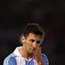 Argentina's Leonel Messi pauses on the field as they played Venezuela in a 2014 World Cup qualifying soccer match in Buenos Aires March 22, 2013. REUTERS/Marcos Brindicci