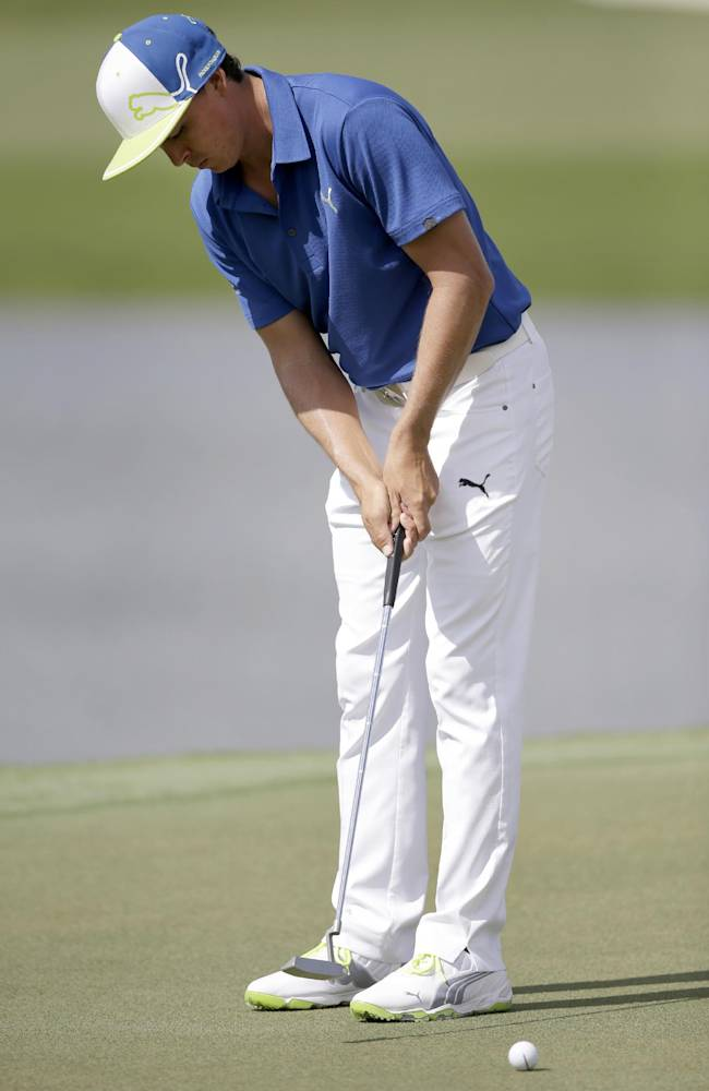 Rickie Fowler putts on the ninth hole during a practice round of the Cadillac Championship golf tournament, Wednesday, March 5, 2014 in Doral, Fla