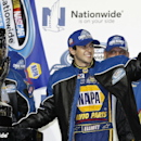 Chase Elliott celebrates after winning the championship at the NASCAR Nationwide series championship auto race, Saturday, Nov. 15, 2014 in Homestead, Fla. (AP Photo/David Graham)