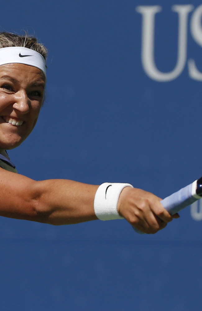 Victoria Azarenka, of Belarus, reaches for a shot against Christina McHale, of the United States, during the second round of the 2014 U.S. Open tennis tournament, Thursday, Aug. 28, 2014, in New York