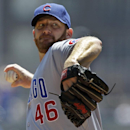 File-This July 25, 2012 file photo shows Chicago Cubs pitcher Ryan Dempster pitching during the second inning of a baseball game against the Pittsburgh Pirates in Pittsburgh. The Texas Rangers have obtained Ryan Dempster from the Chicago Cubs, a move to