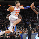 New York Knicks' Andrea Bargnani, left, drives under the basket as Orlando Magic center Glen Davis defends during the second quarter of an NBA basketball game on Friday, Dec. 6, 2013, at Madison Square Garden in New York. (AP Photo/Bill Kostroun)