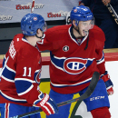 Montreal Canadiens center Alex Galchenyuk, right, celebrates with teammate Brendan Gallagher after scoring a hat trick in the third period to defeat the Carolina Hurricanes 4-1 in an NHL hockey game Tuesday, Dec. 16, 2014, in Montreal The Associated Press