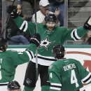 RETRANSMISSION TO CORRECT PERIOD FROM FIRST TO SECOND - Dallas Stars forward Erik Cole, center, is congratulated by defensemen Trevor Daley (6) and Jason Demers (4) after scoring a goal in the second period of an NHL hockey game against the Minnesota Wild