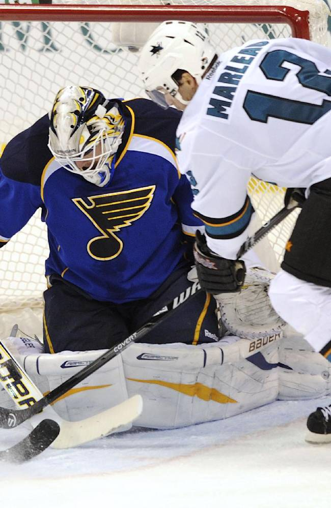 St. Louis Blues goalie Brian Elliot (1) blocks a shot by San Jose Sharks' Patrick Marleau (12) during the third period of an NHL hockey game Tuesday, Oct. 15, 2013, in St. Louis. The Sharks won 6-2