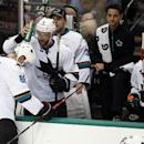 San Jose Sharks' Brent Burns (88) is tapped on the head with a water bottle by Jason Demers (5) as Mirco Mueller, right, watches after Burns scored his second goal, in the third period of an NHL hockey game against the Dallas Stars, Saturday, Nov. 8, 2014