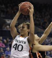 Miami's Shawnice Wilson (40) grabs a rebound in front of Idaho State's Cydney Horton in the first half of an NCAA tournament first-round women's college basketball game Saturday, March 17, 2012, in Spokane, Wash. (AP Photo/Elaine Thompson)