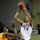 Kansas forward Perry Ellis (34) shoots over Tennessee guard Josh Richardson (1) during the second half of an NCAA college basketball game in Lake Buena Vista, Fla., Friday, Nov. 28, 2014. Kansas won 82-67. (AP Photo/Reinhold Matay)