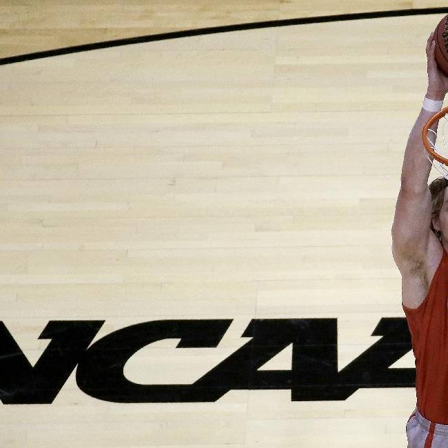New Mexico's Cameron Bairstow dunks the ball during practice for the NCAA college basketball tournament Thursday, March 20, 2014, in St. Louis. New Mexico is scheduled to play against Stanford in a second-round game on Friday