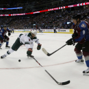 Minnesota Wild defenseman Marco Scandella, center, breaks up a pass from Colorado Avalanche center Matt Duchene, front, to teammate Jarome Iginla during s power-play opportunity in the second period of an NHL hockey game in Denver on Saturday, Oct. 11, 20