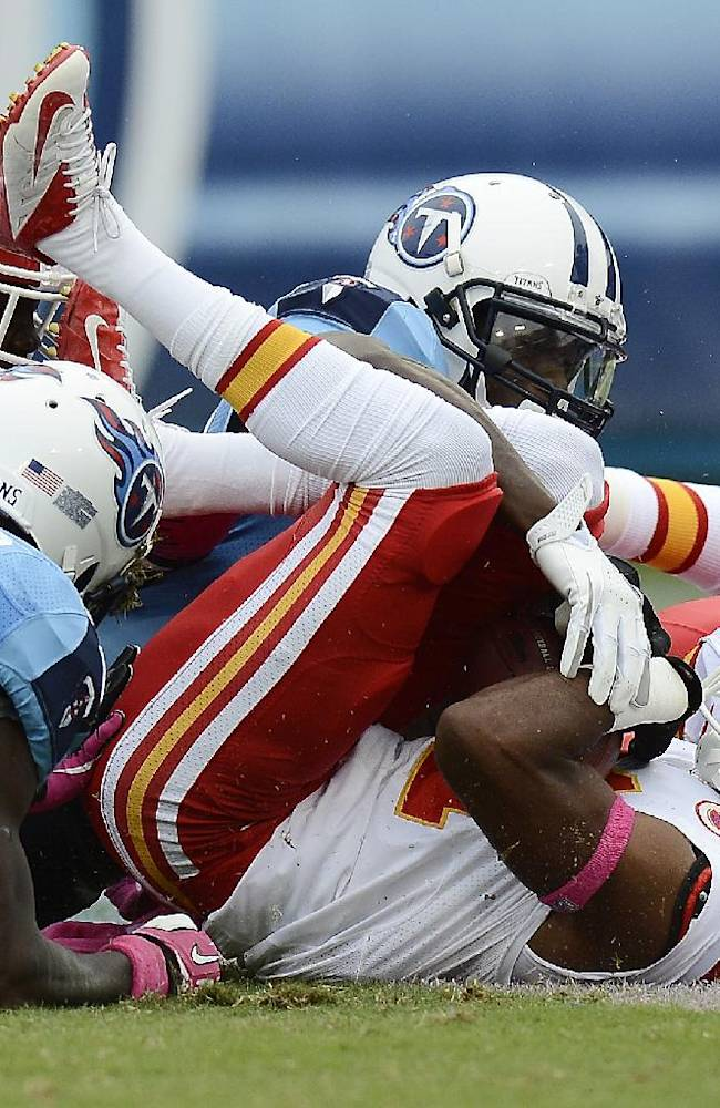 Kansas City Chiefs cornerback Marcus Cooper, front right, recovers a Tennessee Titans fumble in the end zone for a touchdown in the first quarter of an NFL football game on Sunday, Oct. 6, 2013, in Nashville, Tenn. Also scrambling for the ball are Titans' Damian Williams (17) and City Chiefs' Cyrus Gray (32)