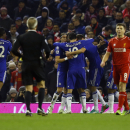 Chelsea's players celebrate Eden Hazard's goal as Liverpool's Steven Gerrard, right, looks on during the English League Cup semi-final first leg soccer match between Liverpool and Chelsea at Anfield Stadium, Liverpool, England, Tuesday Jan. 20, 2015
