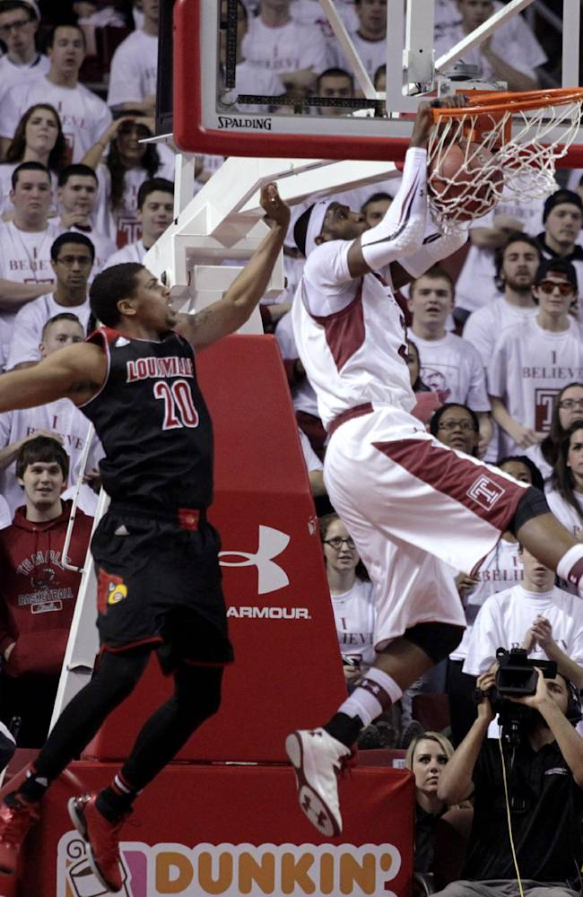 Louisville's Wayne Blackshear (20) defends as Temple's Anthony Lee scores during the first half of an NCAA college basketball game, Friday, Feb. 14, 2014, in Philadelphia