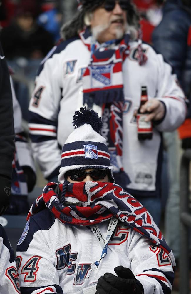 New York Rangers fan Ed Walsh of Fairfield, Conn., is bundled up before an NHL outdoor hockey game between the New Jersey Devils and the New York Rangers at Yankee Stadium in New York, Sunday,Jan. 26, 2014. The temperatures were in the low 20s F before the game