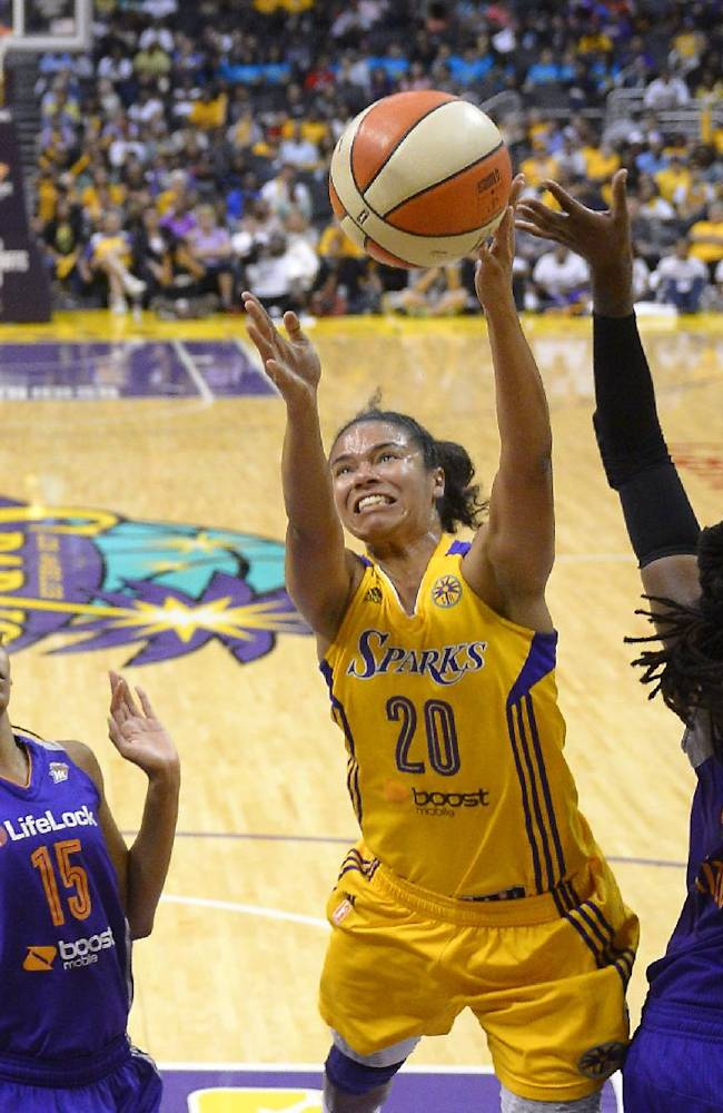 Los Angeles Sparks guard Kristi Toliver, center, puts up a shot as Phoenix Mercury guard Briana Gilbreath, left, and forward Lynetta Kizer defend during the second half in Game 3 of a WNBA basketball Western Conference semifinal series, Monday, Sept. 23, 2013, in  Los Angeles. The Mercury won 78-77