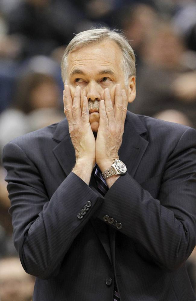 Los Angeles Lakers head coach Mike D'Antoni disagrees with a call during the first quarter of an NBA basketball game against the Minnesota Timberwolves in Minneapolis, Friday, March 28, 2014. The Timberwolves won 143-107