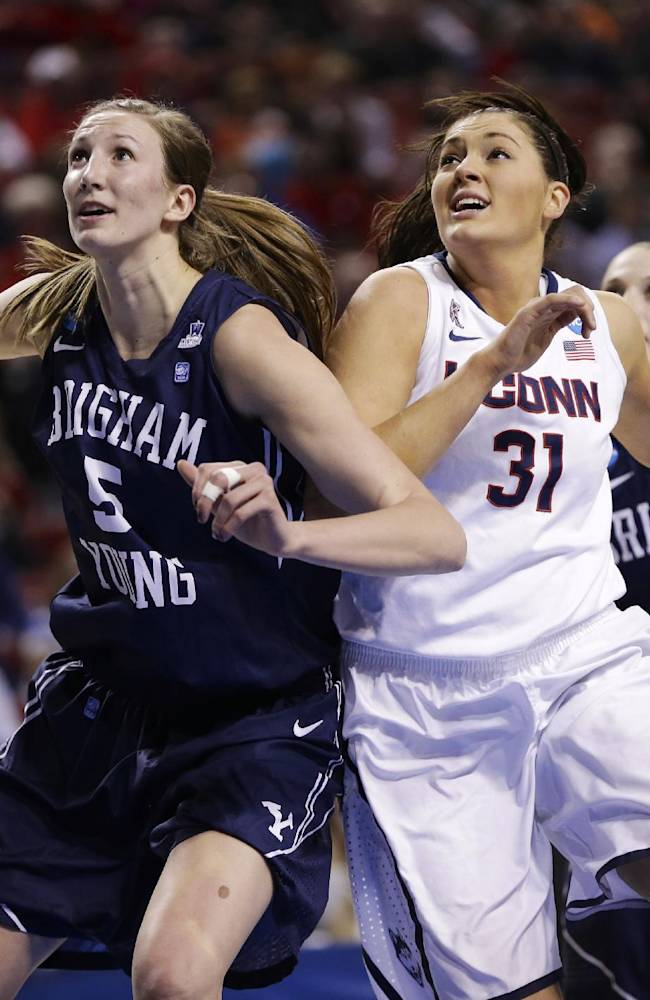 BYU's Jennifer Hamson (5) and Kim Beeston (4), jockey for position against Connecticut's Stefanie Dolson (31)  during the first half of a regional semifinal in the NCAA college basketball tournament in Lincoln, Neb., Saturday, March 29, 2014