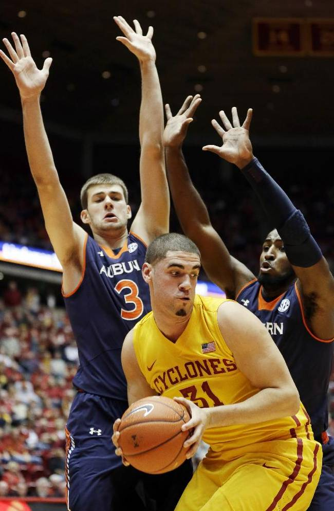 Iowa State forward Georges Niang, center, looks to pass in front of Auburn defenders Benas Griciunas, left, and KT Harrell, right, during the first half of an NCAA college basketball game Monday, Dec. 2, 2013, in Ames, Iowa