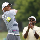 Tiger Woods watches his tee shot on the 11th hole during the pro-am for the Greenbrier Classic golf tournament at the Greenbrier Resort in White Sulphur Springs, W.Va., Wednesday, July 1, 2015. (AP Photo/Steve Helber)
