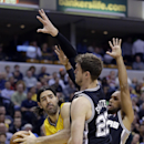 Indiana Pacers forward Luis Scola, left, is trapped by San Antonio Spurs center Tiago Splitter, center, and guard Patty Mills in the first half of an NBA basketball game in Indianapolis, Monday, March 31, 2014 The Associated Press