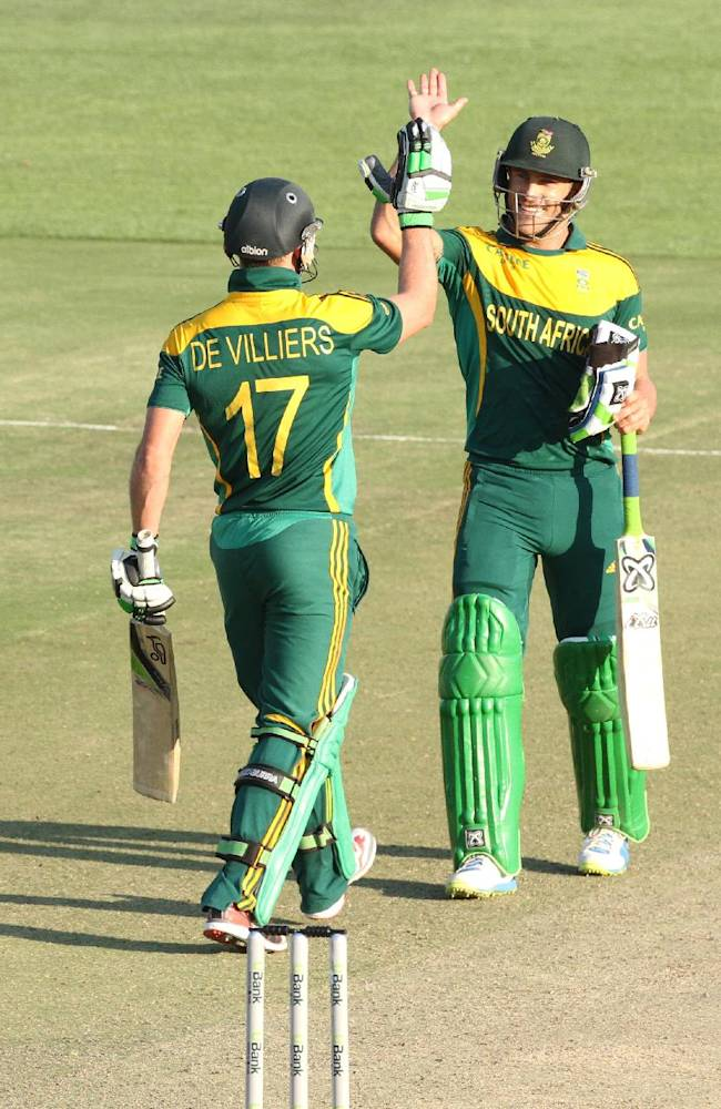 South African player Faf du Plessis, right, celebrates with AB de Villiers after scoring 100 runs during the   cricket One Day International match against Australia in  Harare Zimbabwe Wednesday, Aug. 27, 2014. The two teams are in Zimbabwe for a triangular  ODI series with Zimbabwe