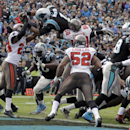 Carolina Panthers' Cam Newton (1) dives over the goal line for a touchdown as Tampa Bay Buccaneers' Darrelle Revis (24) defends in the first half of an NFL football game in Charlotte, N.C., Sunday, Dec. 1, 2013 The Associated Press