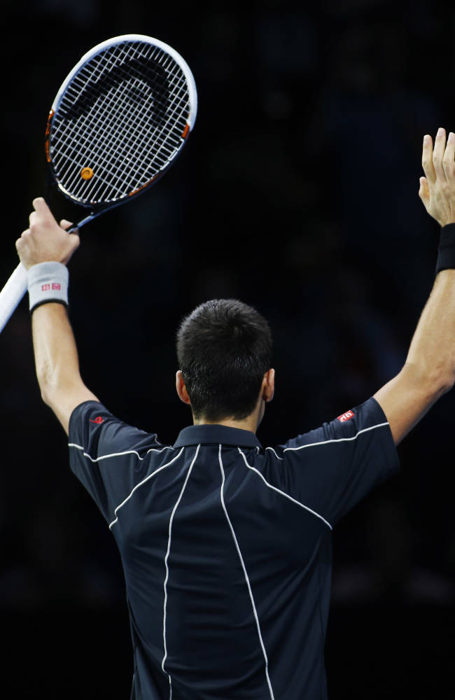 Novak Djokovic of Serbia celebrates his win against Stanislas Wawrinka of Switzerland at the end of their ATP World Tour Finals single semifinal tennis match at the O2 Arena in London Sunday, Nov. 10, 2013
