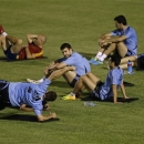 Spain's Gerard Pique, center, smiles at the end of a training session at the soccer Confederations Cup in Fortaleza, Brazil, Monday, June 24, 2013. Spain will face Italy at Confederations Cup semifinals Thursday. (AP Photo/Natacha Pisarenko)