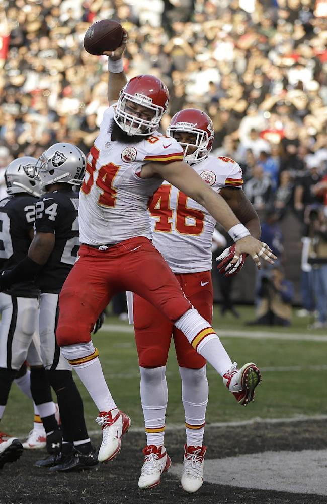 Kansas City Chiefs tight end Sean McGrath (84) celebrates with tight end Dominique Jones (46) after scoring on a 6-yard touchdown reception from quarterback Alex Smith during the third quarter of an NFL football game in Oakland, Calif., Sunday, Dec. 15, 2013