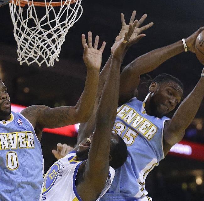 Denver Nuggets' Kenneth Faried, right, rebounds the ball over Golden State Warriors' Draymond Green (23) during the first half of an NBA basketball game Thursday, April 10, 2014, in Oakland, Calif. At left is Nuggets' Aaron Brooks