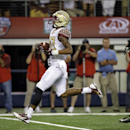 Florida State wide receiver Rashad Greene runs into the end zone for a touchdown as Oklahoma State cornerback Ashton Lampkin (6) gives chase in the second half of an NCAA college football game, Saturday, Aug. 30, 2014, in Arlington, Texas. FSU won 37-31 T